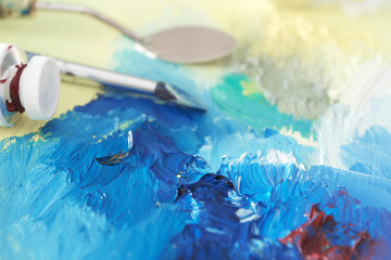 Colorful oil paint with accessories, closeup