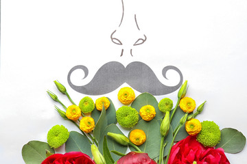 Card with moustache and beautiful flower composition, closeup