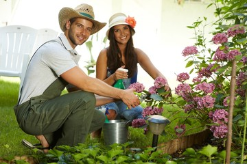 Attractive young couple gardening together