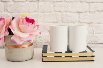 Two Mugs. White Mugs Mockup. Blank White Coffee Mug Mock Up. Styled Photography. Coffee Cup Product Display. Two Coffee Mugs On Striped Design Notebooks. Vase With Pink Roses