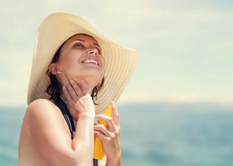 Woman in big straw hat enjoy with summer sun