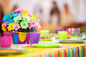 Serving colorful table with decoration for child birthday