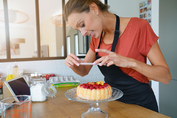 Blogger taking picture of cake to upload on website