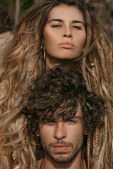 Beautiful boho style man and woman outdoors