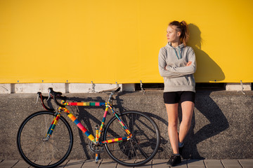 Young woman riding a bicycle and relax in the morning city