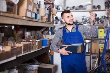Male worker sorting sanitary engineering details