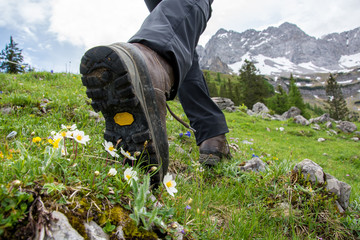 Hiking in the mountains with hiking boots