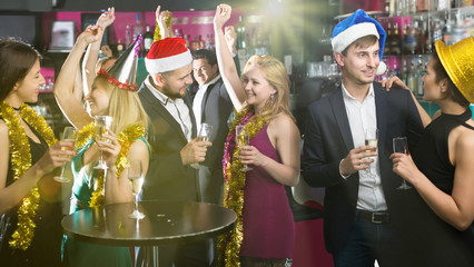 Positive females and males celebrating new year