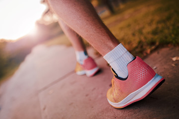 Runner during the training in the park. Closeup photo of legs and running shoes. Sport, fitness, workout concept