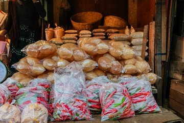 Packed red hot chili peppers and rolls in a local Bhutanese marketplace