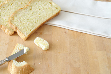 Bread and butter on the kitchen table, top view