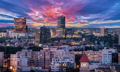 Aerial view of the business district in Bucharest, Romania at sunset. Wall mural