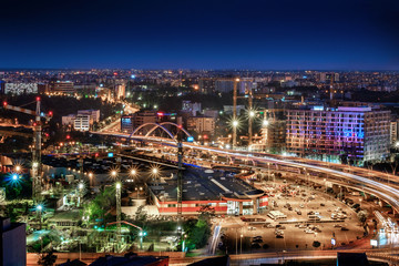 Aerial wide angle view of Bucharest Basarab, Romania. Traffic and buildings at night.