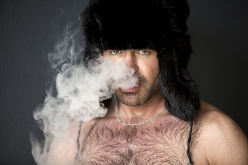 portrait of man with naked chest smoking cigarette