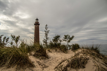 Lake Michigan Lighthouse. Little Sable Lighthouse on the shores of Lake Michigan surrounded by sand dunes and dune grass. Silver Lake State Park.