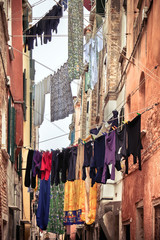 Venice hangs out the clothes. the objects are drying in the sun