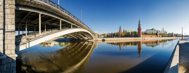 Morning panoramic view of BolshoMorning view of Bolshoy Kamenny Bridge over Moskva River, embankments, Kremlin Towers in Moscow, Russia.