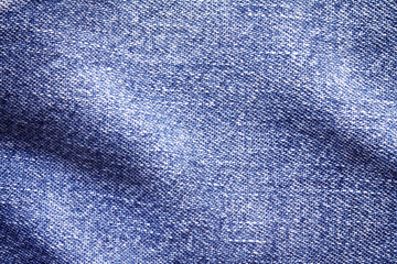 Close up  denim bright  blue jeans surface with wave texture background
