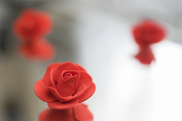 Small artificial red roses for decoration