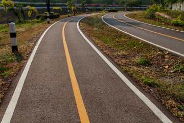 Bicycle lane signage on asphalt road.
