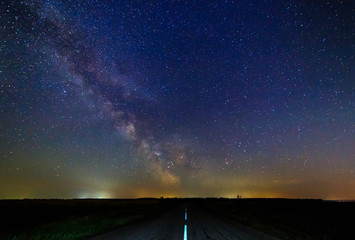 Milky way and starry sky over the road.
