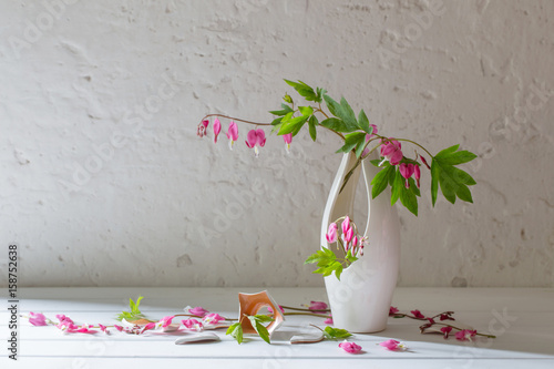 Pink Flowers In Broken Vase On Old White Background Stock Photo And