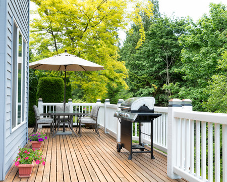 Home deck and patio with outdoor furniture and BBQ cooker