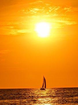 Sailboat Silhouette in deep orange and yellow sunset Puerto Vallarta Mexico