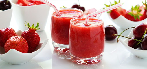 Delicious and healthy desserts strawberries smoothies and yogurt on white background. banner