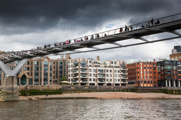 LONDON/UK - MAY 20 : Pedestrians crossing Millenium Bridge, London. View from the river