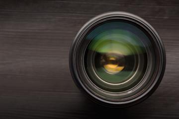 Camera lens close up isolated on dark background.