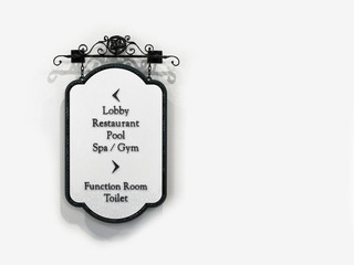 Vintage sign guide to lobby, restaurant, pool, spa, gym, function room and rest room, isolated on white background.