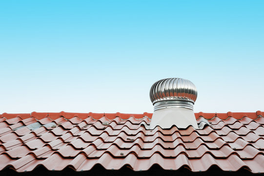air vent on the red roof outdoor (roof, ventilation, roofing)