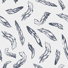 Vector seamless pattern with hand-drawn feathers.