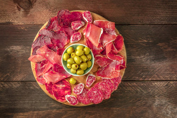 Overhead photo of Spanish cold meats platter with olives