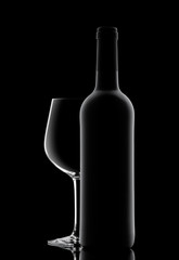 Silhouette of a bottle with wine on a black background