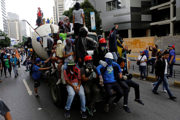 Demonstrators ride on a truck during a rally against Venezuelan President Nicolas Maduro's government in Caracas,