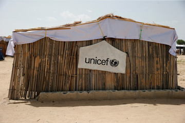 UNICEF logo banner is seen hanging on a makeshift school at IDP camp on the outskirts of Maiduguri