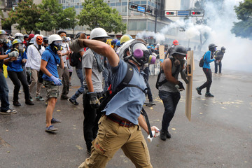 Demonstrators clash during riots at a rally against Venezuelan President Nicolas Maduro's government in Caracas