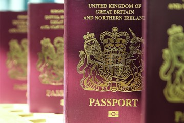 Five British United Kingdom European Union Biometric passports standing in a queue in shallow focus
