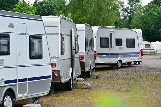 New touring caravans parked in a row on a travel trailer trade park