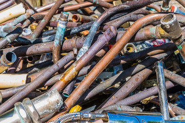 Recycling metals industry, a pile of scrap metal copper ready to be recycled.