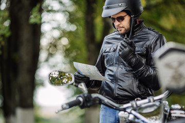 man with motorcycle. people, travel lifestyle concept