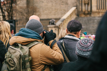Photographer takes a photo in a crowd