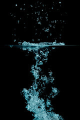 Splashing water with oxygen bubbles. Underwater background