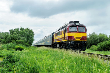 Passenger train with a diesel locomotive.
