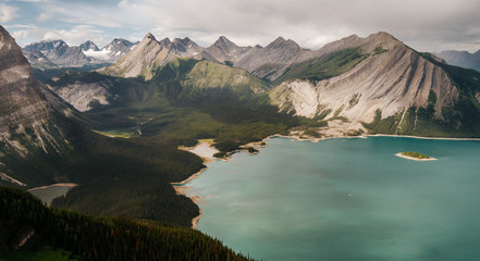 Scenic View Of Rocky Mountains And Lake Against Cloudy Sky