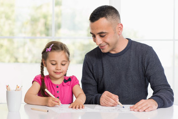 Little Girl And Father Drawing Pictures Together