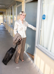 Businesswoman in exterior of hotel