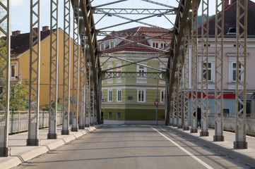 Bridge with beautiful old town buildings at its end